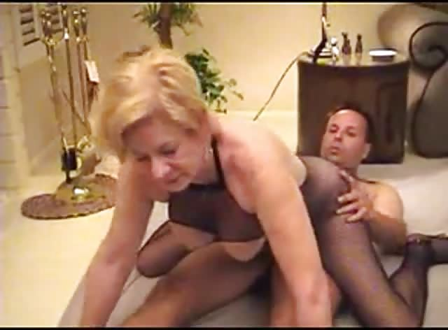 Mature in Fishnes Rides Young Dick